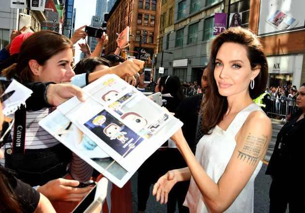 Angelina Jolie signing autographs at TIFF. (Photo by George