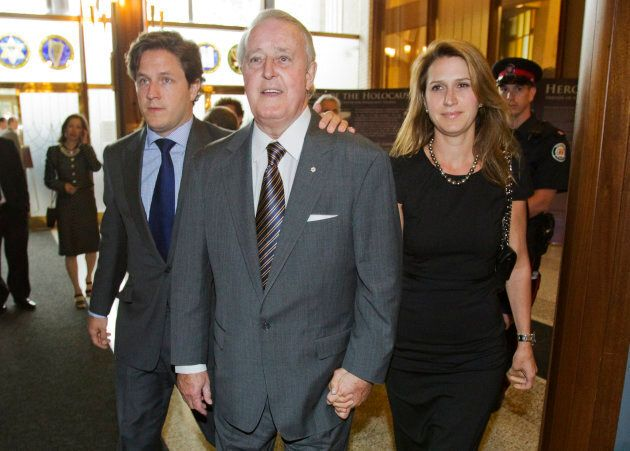 Former Canada Prime Minister Brian Mulroney arrives with his son Mark (L) and daughter Caroline (R) at...