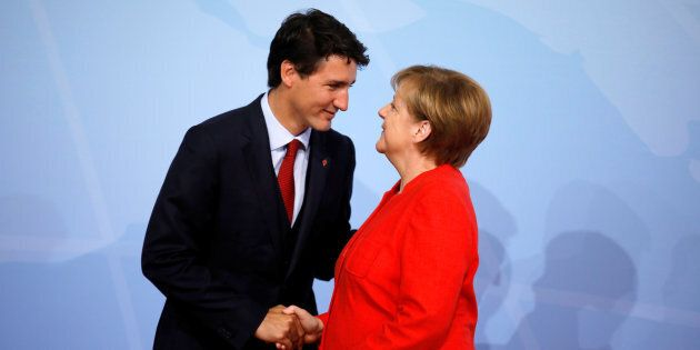 German Chancellor Angela Merkel welcomes Prime Minister Justin Trudeau at the G20 summit in Hamburg,...