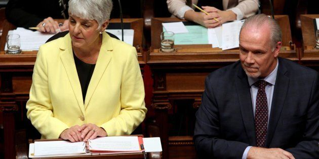 B.C. Finance Minister Carole James delivers the budget as Premier John Horgan looks on from the legislative...