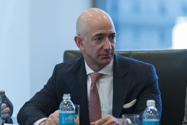 Jeffrey Bezos, president and chief executive officer of Amazon.com Inc., listens during a meeting with...