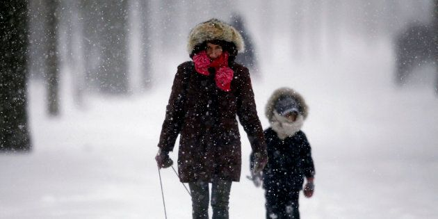 Alyssa Gerber walks through a Toroto park during a snowstorm on Dec. 14,