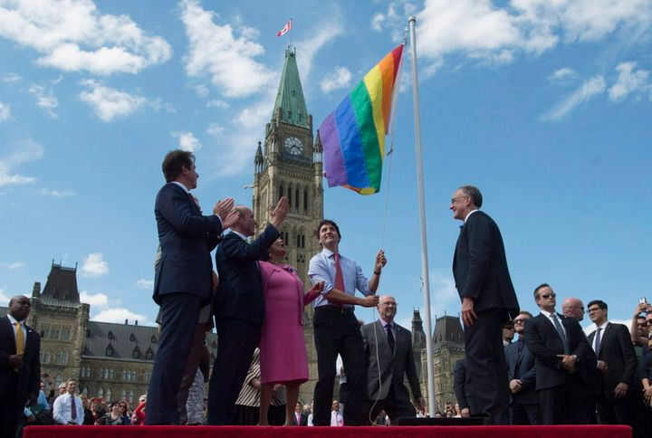 Prime Minister Justin Trudeau takes part in a Pride flag raising ceremony on Parliament Hill on June 1, 2016.