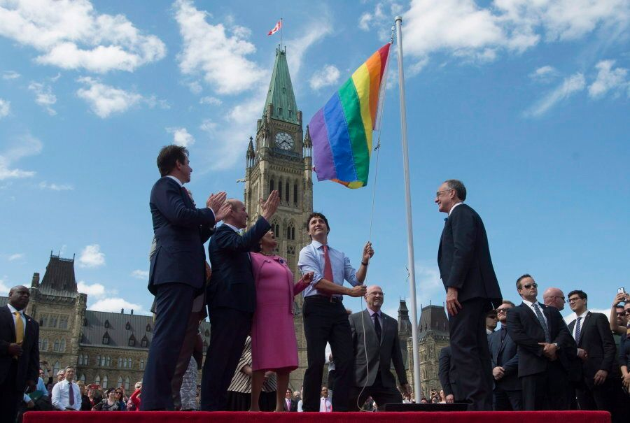 Prime Minister Justin Trudeau takes part in a Pride flag raising ceremony on Parliament Hill on June...