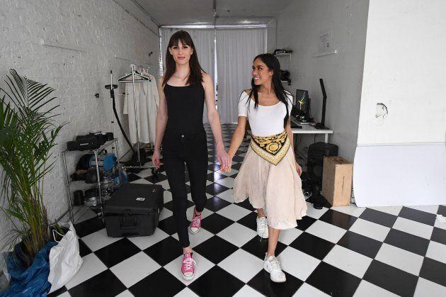 Peche Di, model and founder of  transgender model agency (R) practices a runway walk with transgender model Dusty Rose from Alabama on September 5, 2017 in New York City. (ANGELA WEISS/AFP/Getty Images)