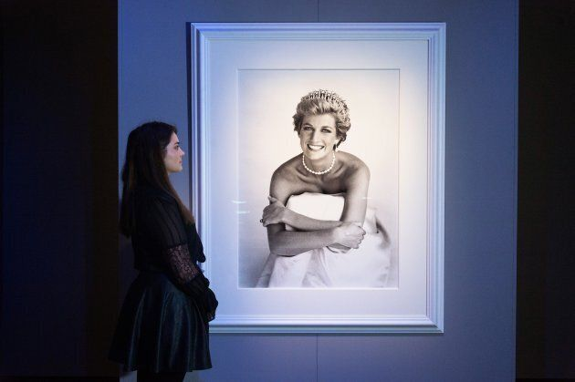 Gallery staff views a photographer of Diana, Princess of Wales for British Vogue, December 1990 by photographer...