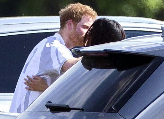 Prince Harry and Meghan Markle embrace following the polo at Cowarth Park Audi Polo Challenge at Coworth,...