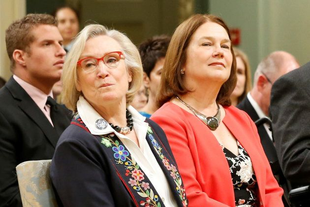 Canada's Minister of Crown-Indigenous Relations and Northern Affairs, Carolyn Bennett, left, and Minister of Indigenous Services Jane Philpott take part in a cabinet shuffle at Rideau Hall in Ottawa on August 28, 2017.