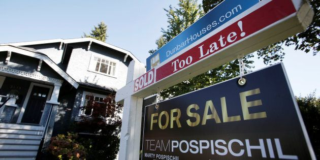 A real estate for sale sign is pictured in front of a home in Vancouver, British Columbia, Canada, September...
