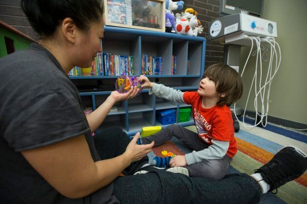 Ting Chan (left) and her son Tristan Chan Wymant, 5, interact together at Holland Bloorview Kids Rehabilitation Hospital. (Rick Madonik/Toronto Star via Getty Images)