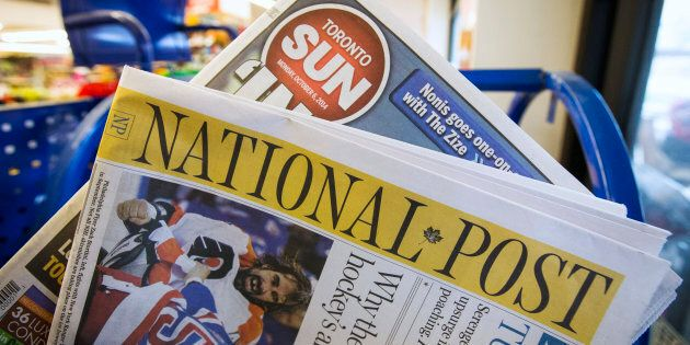 Toronto Sun and National Post newspapers are posed in front of a news stand in Toronto, October 6,