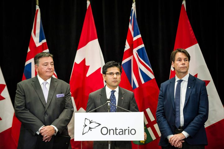 Ontario Attorney General Yasir Naqvi, centre, Minister of Finance Charles Sousa, left, and Minister of Health and Long-Term Care Eric Hoskins speak during a press conference where they detailed Ontario's solution for recreational marijuana sales, in Toronto, Ont. on Friday, Sept. 8, 2017.