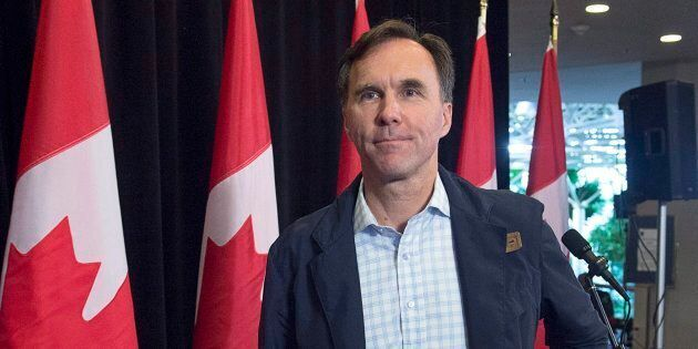 Finance Minister Bill Morneau heads from the podium after talking with reporters as the Liberal cabinet meets in St. John's, N.L. on Tuesday, Sept. 12, 2017.