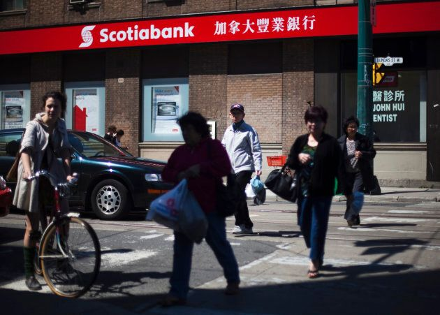 People walk by a Scotiabank in Chinatown in Toronto, April 30,
