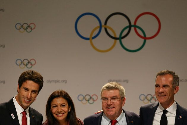 International Olympic Committee member and co-chairman of Paris 2024 Tony Estanguet, Mayor of Paris Anne Hidalgo, IOC President Thomas Bach and Mayor of Los Angeles Eric Garcetti pose for photo after a news conference during the 131st IOC session in Lima on Wednesday.
