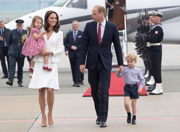 The Duke and Duchess of Cambridge with their children in Warsaw, Poland in July. (Photo by Arthur Edwards...
