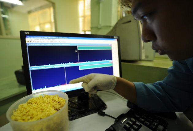 A Philippine research specialist points to spectrum peak of radioactive material in japanese food samples...