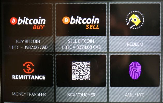 Commands on a Bitcoin ATM are seen at a restaurant in Toronto, Ont., June 3, 2017.