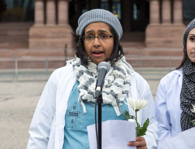 Dr. Nadia Alam addresses people and media against the cuts to health care from the Liberal government.