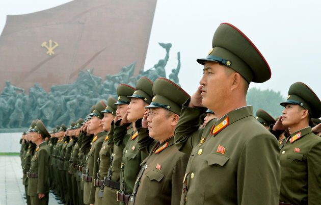 North Korean soldiers salute at Mansudae Hill in Pyongyang in this photo taken by Kyodo on