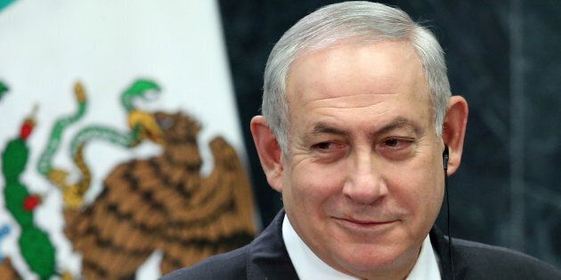 Israeli Prime Minister Benjamin Netanyahu smiles during an address to the media at Los Pinos presidential...