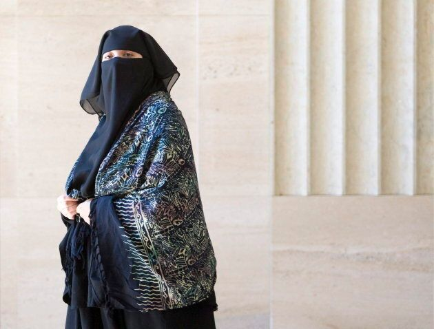 Zaynab Khadr, sister of Omar Khadr, leaves court during a break in hearings in Federal Court in Ottawa...