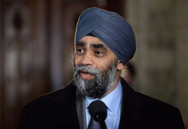 Defence Minister Harjit Sajjan speaks to reporters following a cabinet meeting on Parliament Hill in...