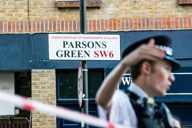 Police officers stand by a cordon at Parsons Green Underground Station. Several people have been injured...