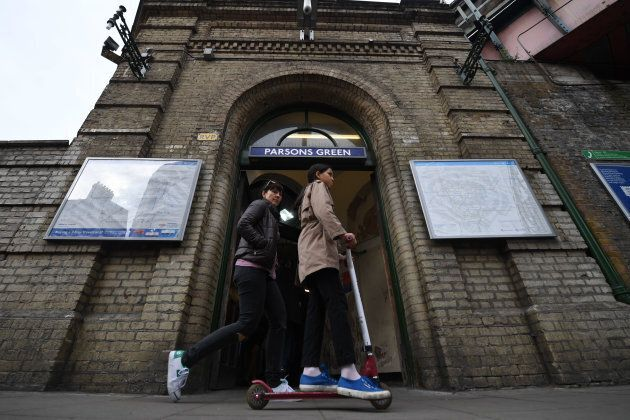 Commuters walk outside Parsons Green station, which was re-opened in the early hours of the morning following...