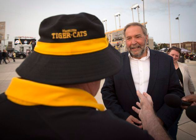 NDP Leader Tom Mulcair speaks with a Tiger-Cats and NDP fan after a media availability to kickoff the...