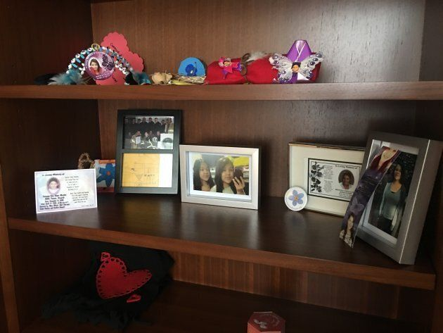 Photos of young people who died in Northern Ontario sit on a bookshelf in Charlie Angus'