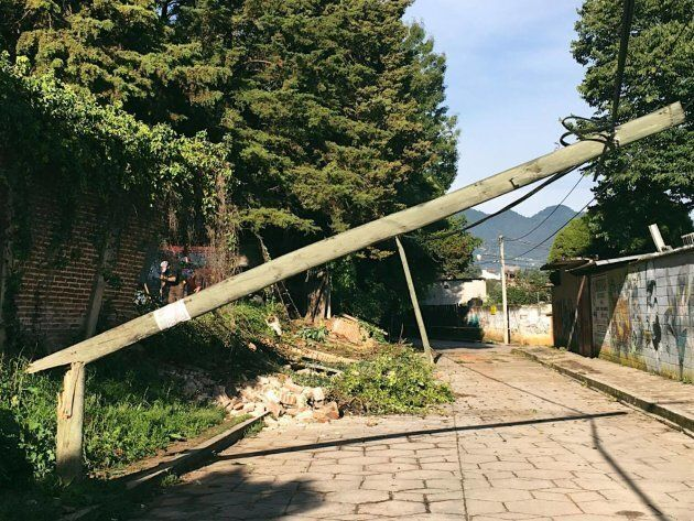 A wall of the Na Bolom Museum had fallen onto the street, taking electric poles with