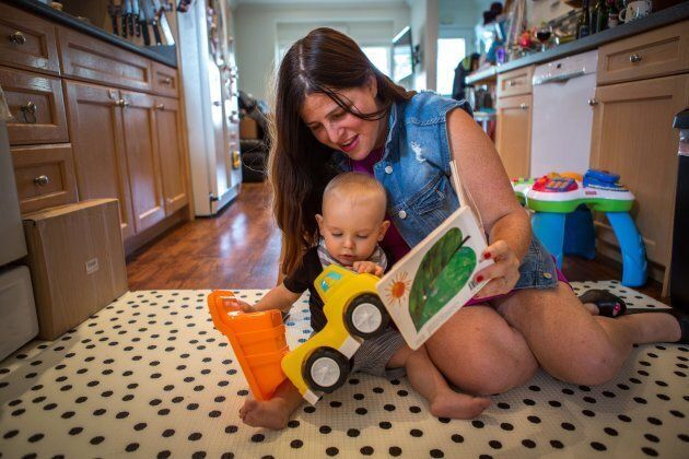 Alana Kayfetz, founder of MomsTO plays with her 1-year-old son Elias Kantor at her Toronto home on
