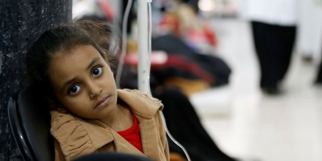 A girl infected with cholera sits on a chair at a hospital in Sanaa, Yemen May 7,