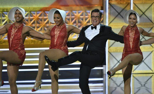Host Stephen Colbert dances onstage during the 69th Emmy Awards at the Microsoft Theatre on September...