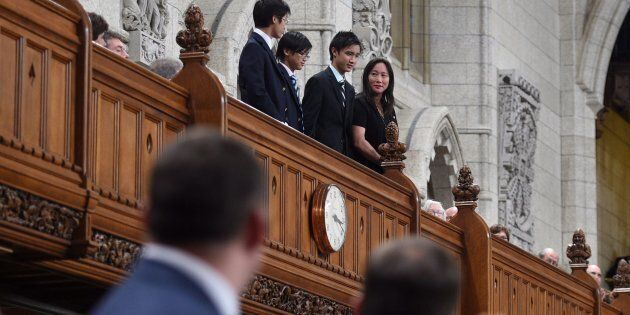 Members of the House of Commons applaud the family of late MP Arnold Chan as they pay tribute in the...