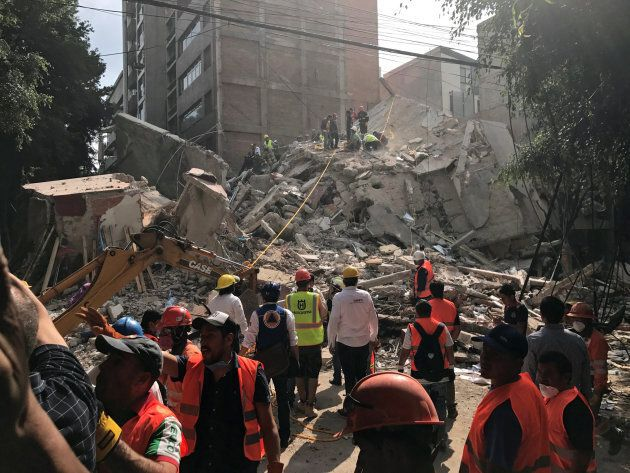 People clear rubble after an earthquake hit Mexico City on