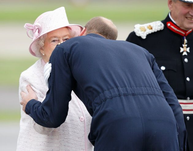 Prince William, Duke of Cambridge kisses his grandmother Queen Elizabeth II goodbye after she opened...