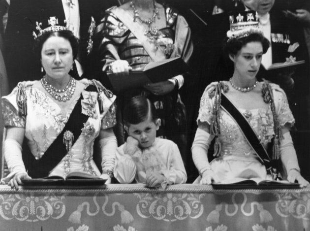 Queen Elizabeth, Queen Mother and Prince Charles with Princess Margaret Rose in the royal box at Westminster...