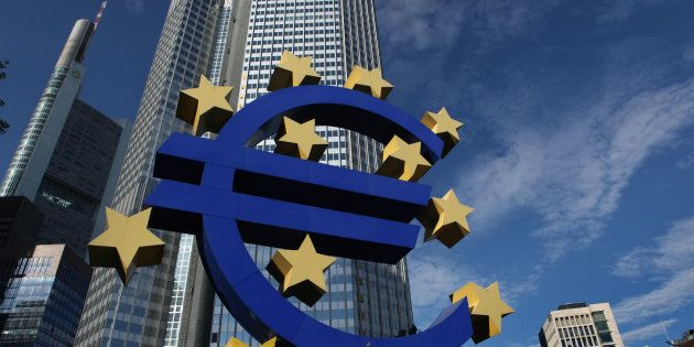The Euro logo ,by German visual artist Ottmar Horl, in front of the Eurotower in Frankfurt am Main, Germany....
