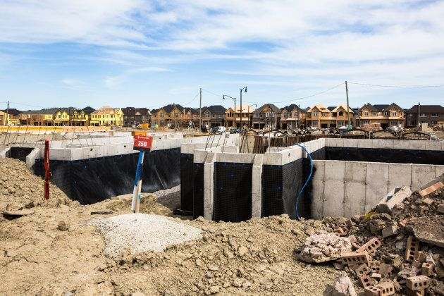 The foundation of a house is seen at a construction site in Brampton, Ont., on May 20,