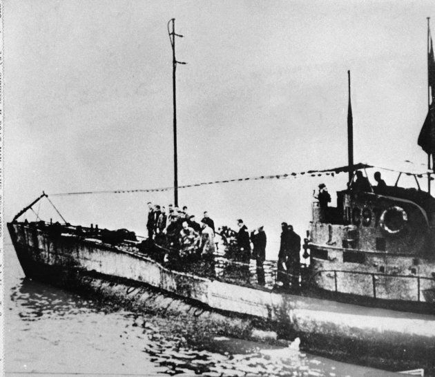 In this undated photo people stand on the deck of a World War I German submarine type UC-97 in an unknown