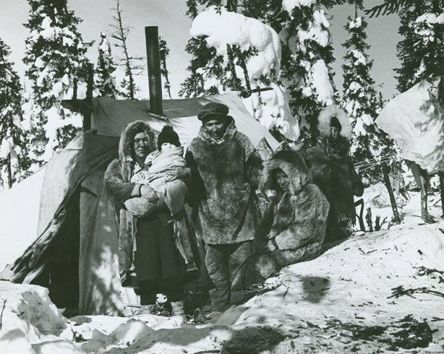 A Sayisi Dene family is photographed near Duck Lake, Man. in 1947. The family members are Mary Ann Thorassie,...