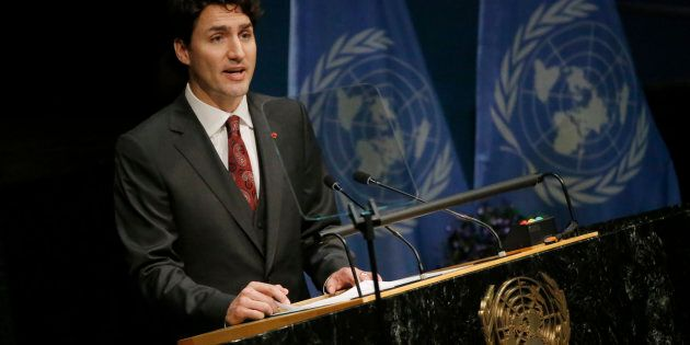 Prime Minister Justin Trudeau delivers his remarks during the signing ceremony on climate change held...