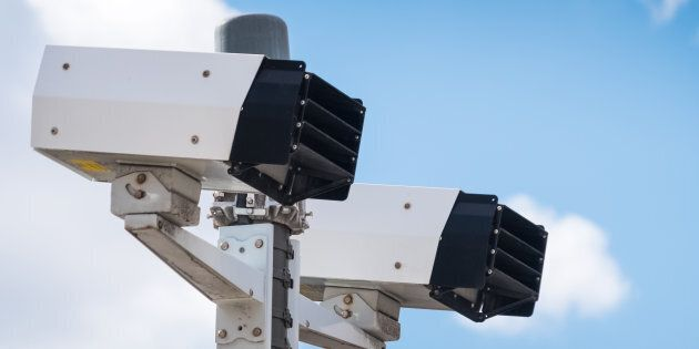 Modern speed camera with sky on the