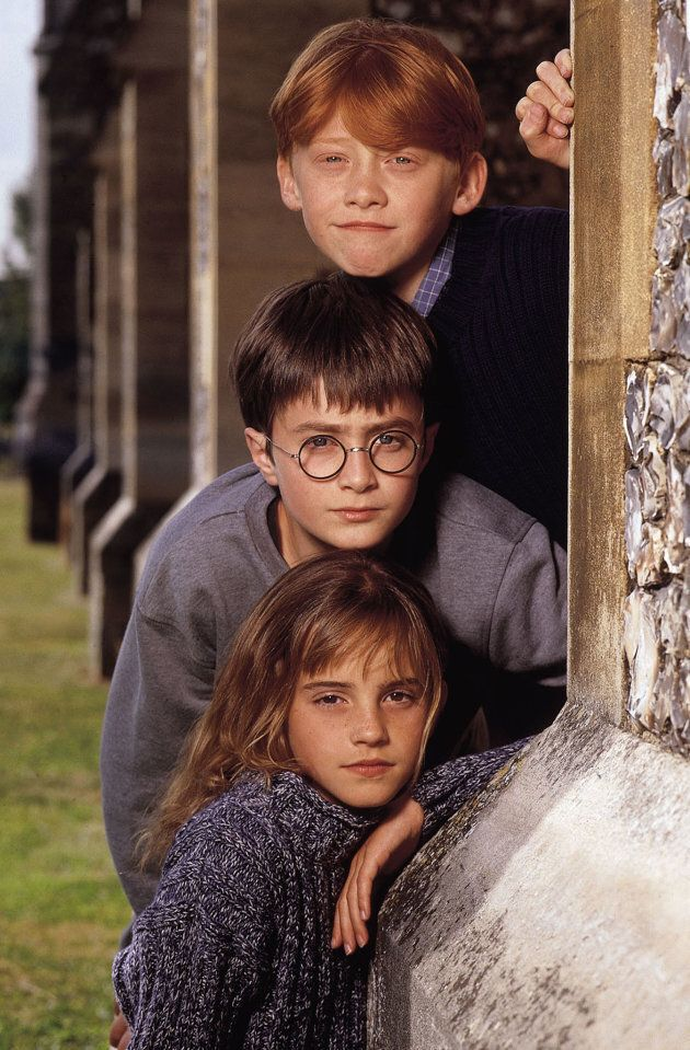 Rupert Grint as Ron Weasley, Daniel Radcliffe as Harry Potter and Emma Watson as Hermione