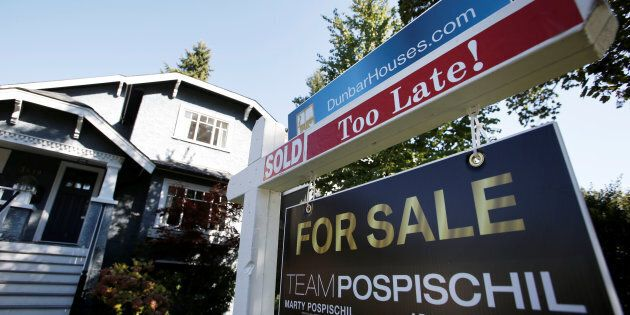 A for sale sign is pictured in front of a home in Vancouver, B.C., Sept. 22, 2016. A proposal by Canada's...