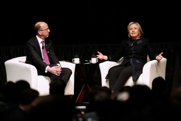Former U.S. Secretary of State Hillary Rodham Clinton, right, speaks to Victor Dodig, President and CEO of CIBC in Winnipeg on Jan. 21, 2015.