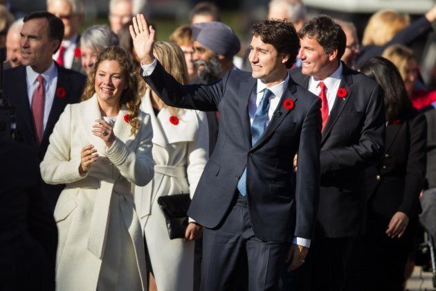 Justin Trudeau, prime minister designate at the time, leads his cabinet appointees up the drive at Rideau...