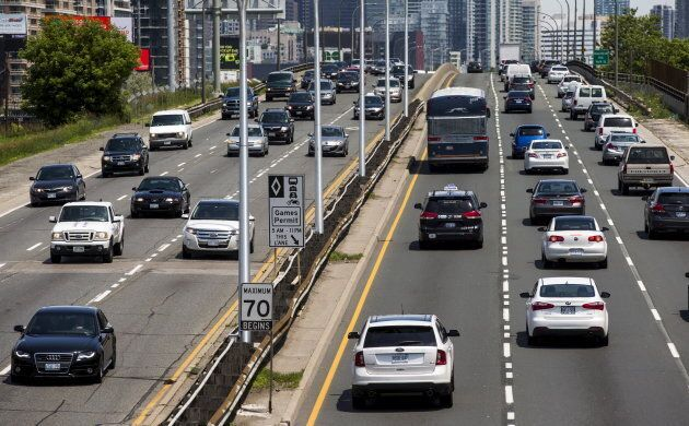 Cars drive in heavy traffic on the Gardiner Expressway in Toronto, June 29,